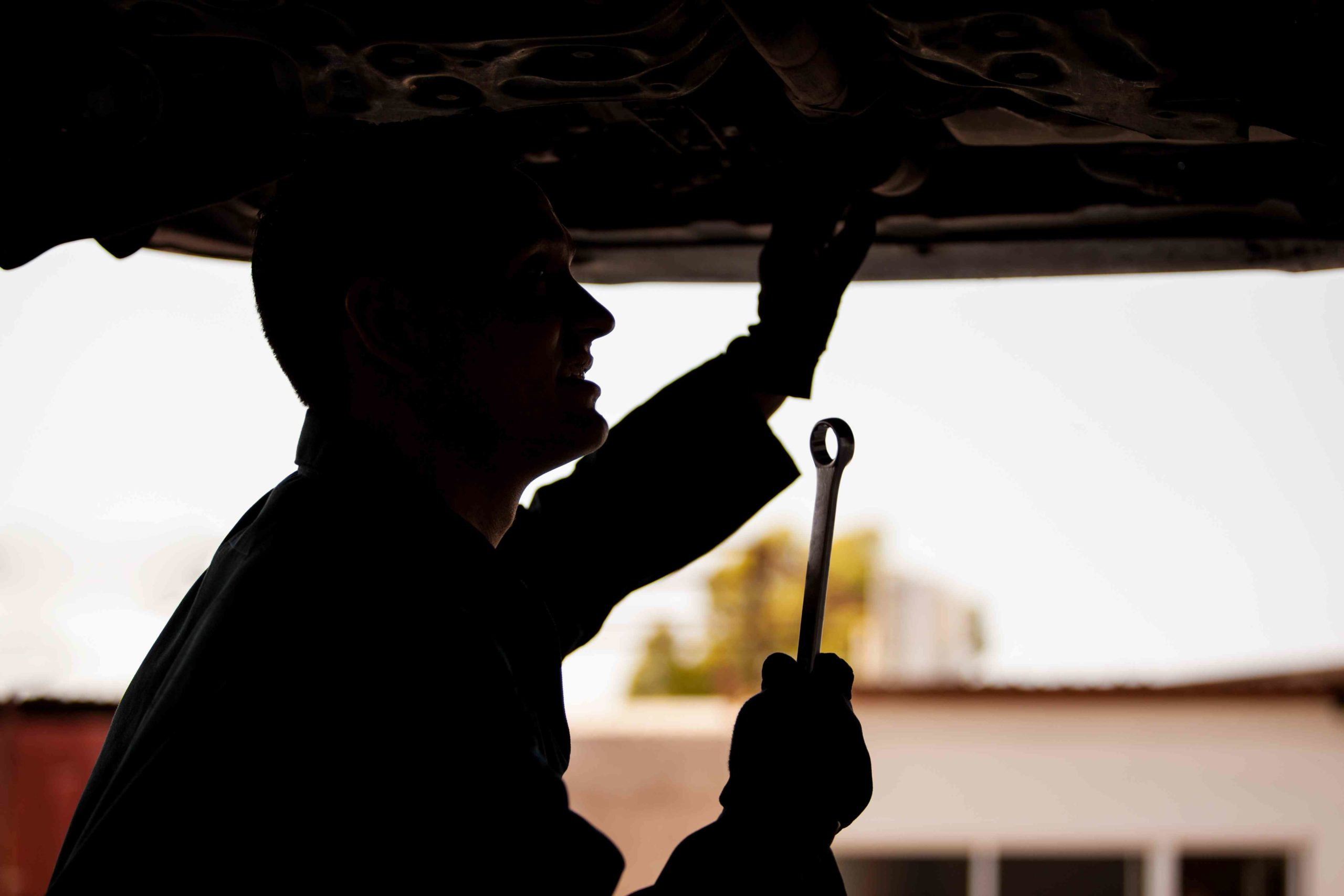 auto repair technician working on a car